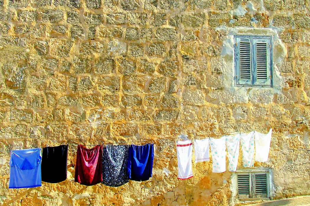 lavare abbigliamento running